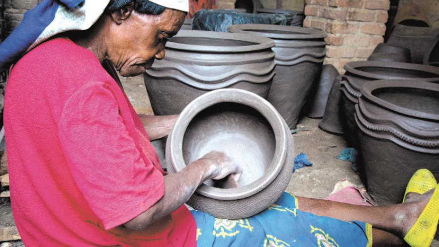 Working under a cooperative helps potters get good prices. (Timothy Kisambira)