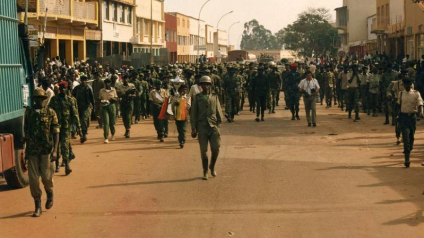 RPA troops walk in Kigali after the fall of the capital in 1994. (Courtesy)