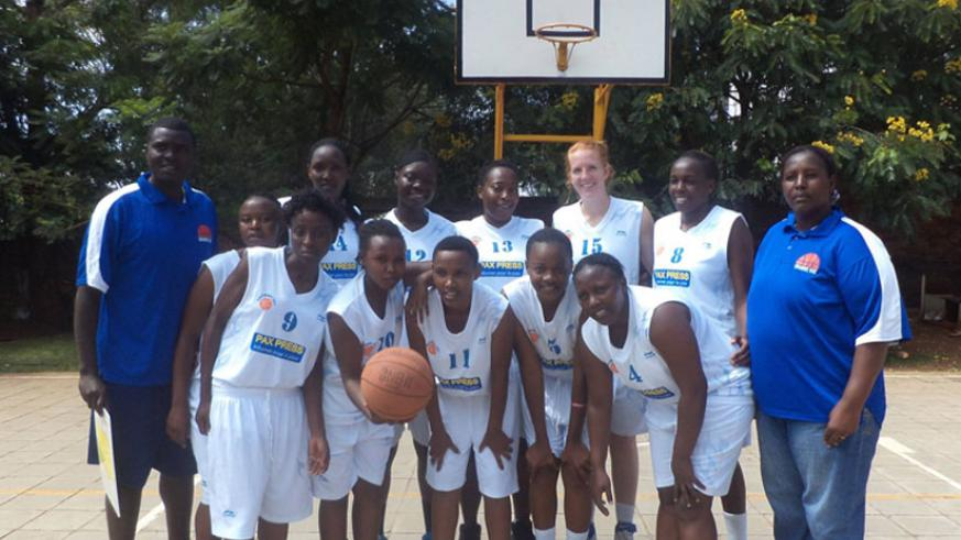 Coach Jacques Bahige (L) with  Ubumwe basketball club players. (R.Bishumba)