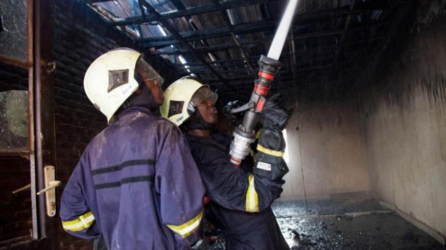 Fire fighters extinguish fire in Nyabugogo on July 14 last year. (Timothy Kisambira)