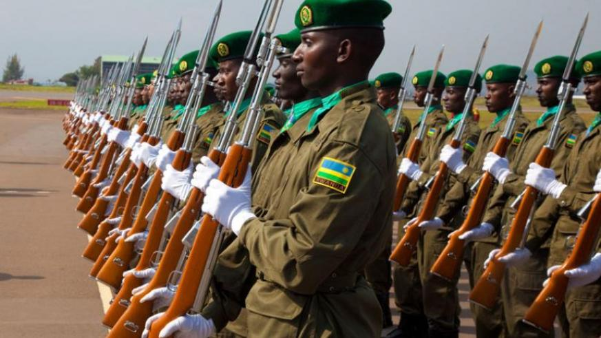 RDF soldiers mount a parade at Kigali International Airport on October 28, 2013. (Timothy Kisambira)