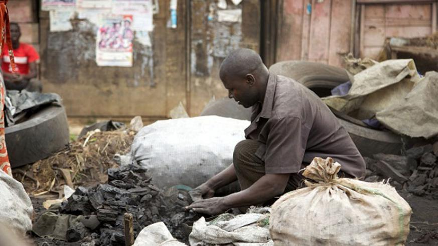 A man sells charcoal. Charcoal is affordable for the majority. (File)