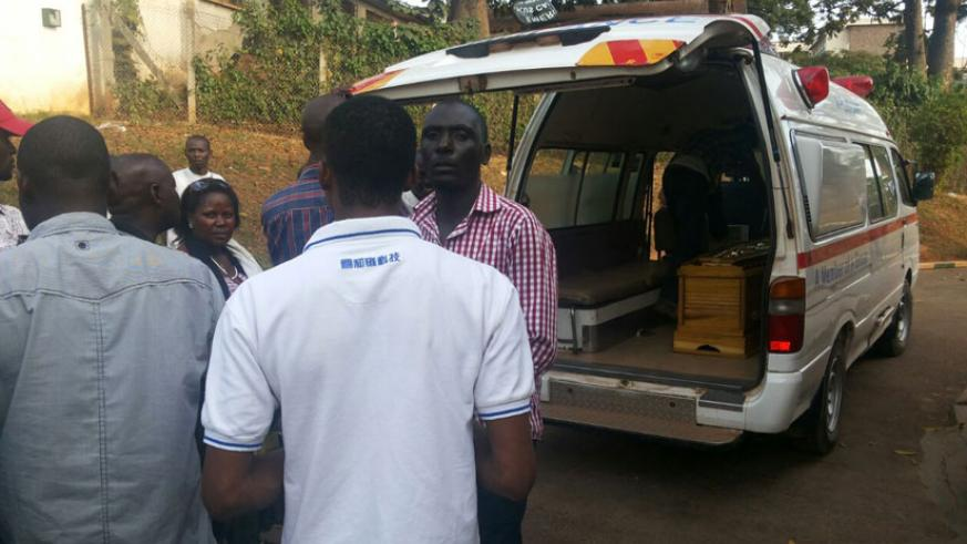 Family and friends put the caskets containing the remains of the deceased onto an ambulance in Mulago Hospital in Kampala yesterday. (Gashegu Muramira)