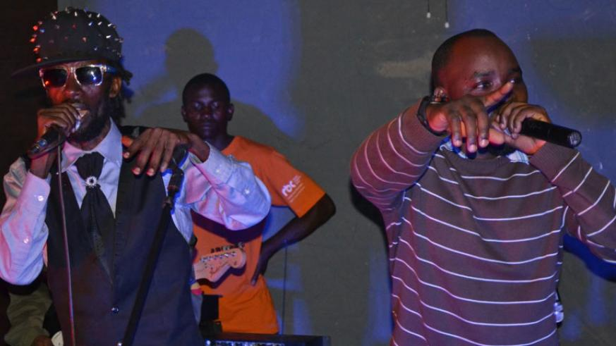 Nikoshwa (L) and MC Tino during a past performance. (Moses Opobo)