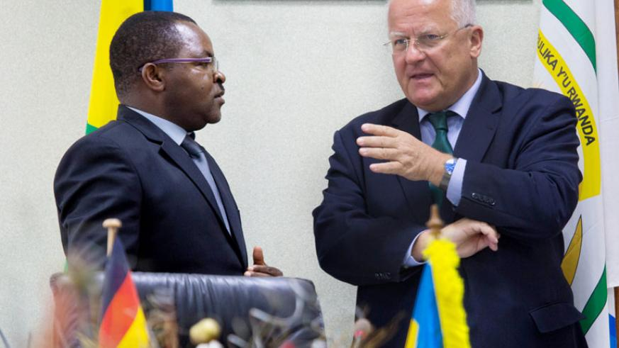 Amb. Fahrenholtz (R) chats with Munyeshyaka at the Ministry of Local Government headquarters in Kigali after the signing ceremony yesterday.