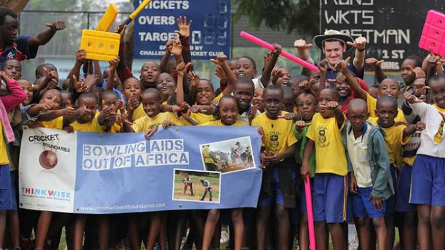 Pupils of Ndera primary school get cricket basic skills from Cricket Without Boundaries trainers last year. Courtesy