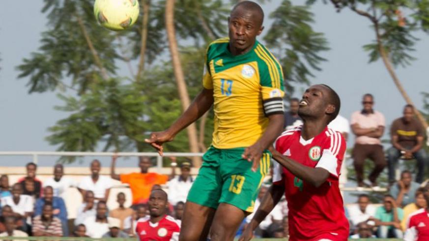Amavubi defender Ismail 'Kodo' Nshutiyamagara heads the ball away during a friendly against Burundi. Rwanda has slipped four places in the February rankings. (File)