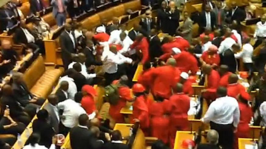 Members of the Economic Freedom Fighters are removed from parliament during President Zuma's address.