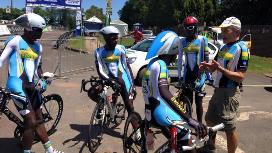 Team Rwanda riders listen to head coach Jonathan Boyer at the continental event in South Africa
