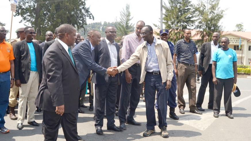Chief Justice Rugege (R) shakes hands with the Prosecutor General Richard Muhumuza as Northern Province Governor Aime Bosenibamwe and other officials look on during the closing ceremony of anti corruption week in the judiciary. (Jean d'Amour Mbonyinshuti)