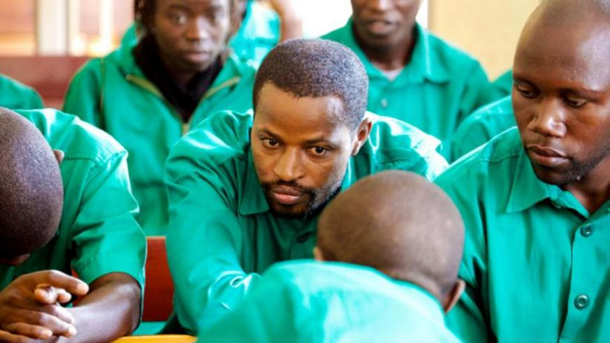 Joel Mutabazi (C) and other co accused during an FDLR-linked terror trial. The case brought to light connections between FDLR and South Africa-based RNC. (File)