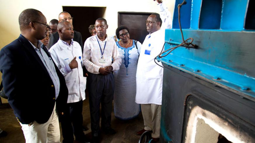 Dr. Hategekimana (R) explains to PAC members how the new incinerator at CHUK works during the legislators' assessment of the facility yesterday. (Timothy Kisambira)