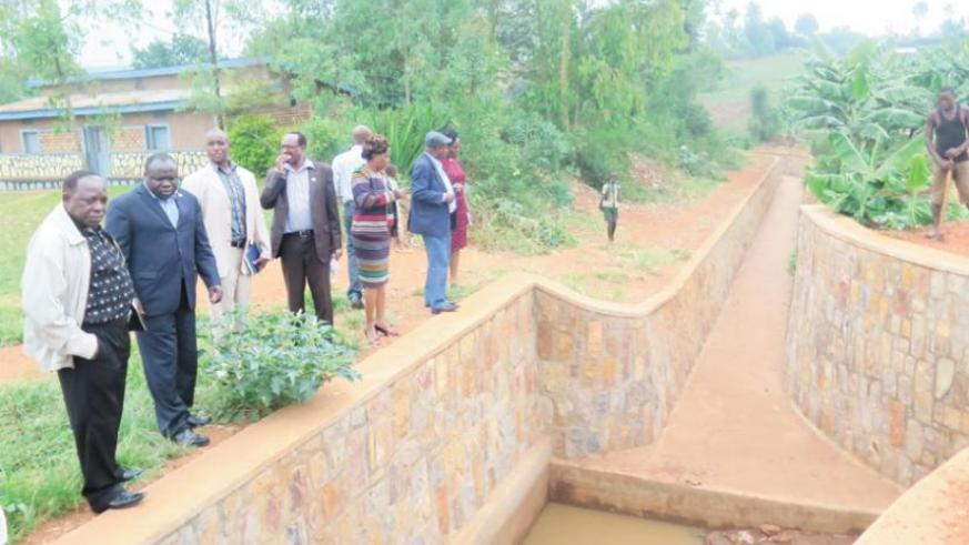 Eala legislators tour a drainage facility in Kayonza District yesterday. (S. Rwembeho)