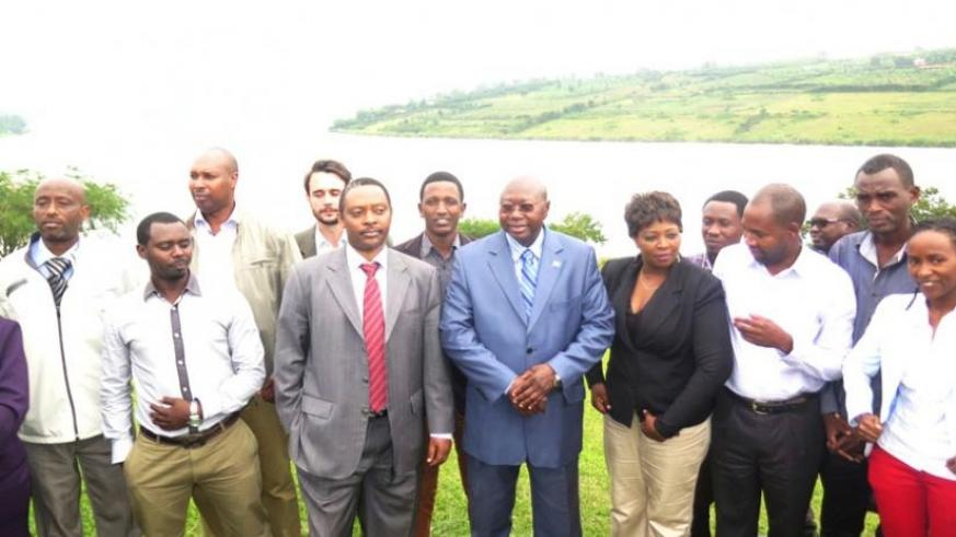 Prof. Shyaka (third left) and Manneh (on his left) are joined by civil society members in a group photo on the shores of Lake Muhazi at the end of the seminar. (Stephen Rembeho)
