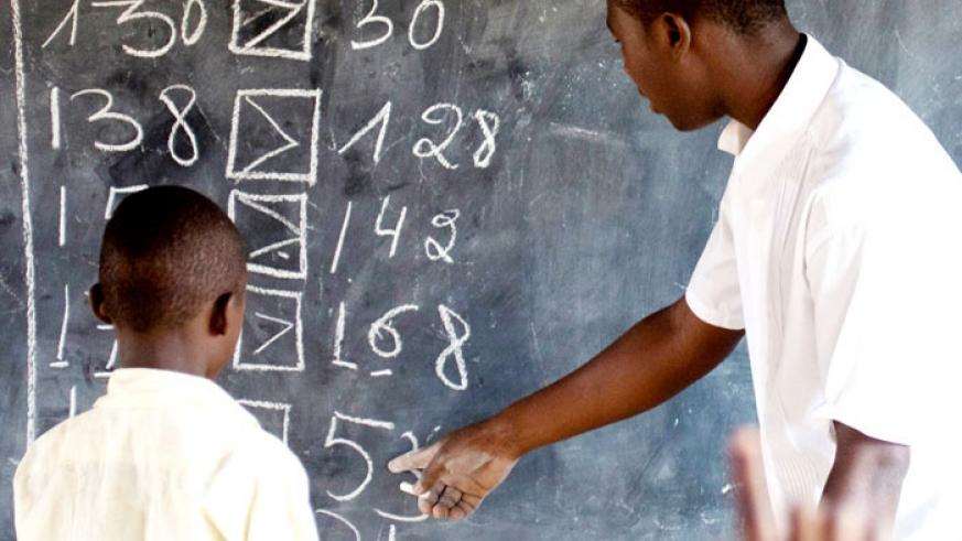 A teacher instructs a pupil at Rusheshe school. (File)