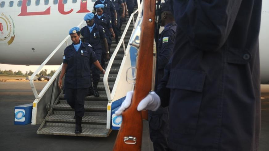 A female police officer returns from a peacekeeping mission. (File)