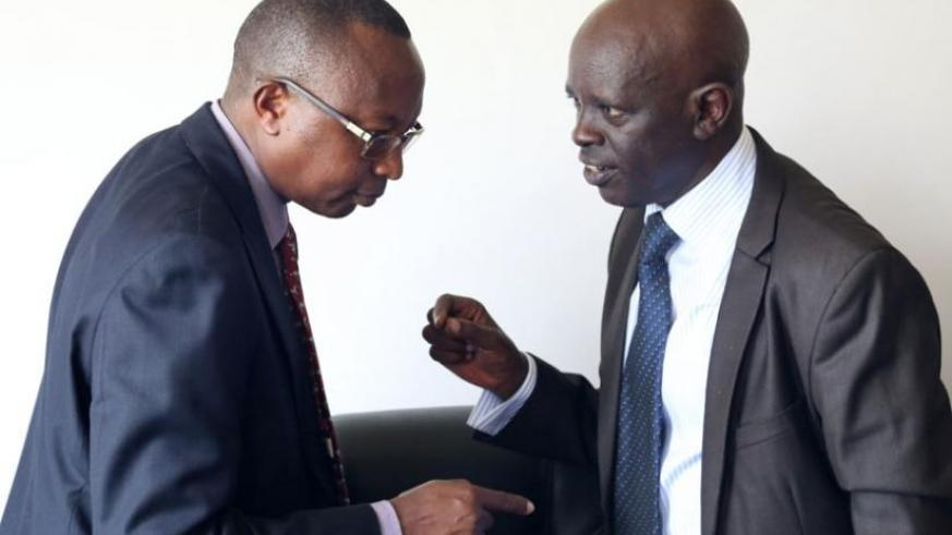 MP Karenzi (R) talks to Auditor-General Obadiah Biraro after a meeting last year. Karenzi and his PAC team have challenged RDB to ensure value for money while undertaking various development projects. (John Mbanda)