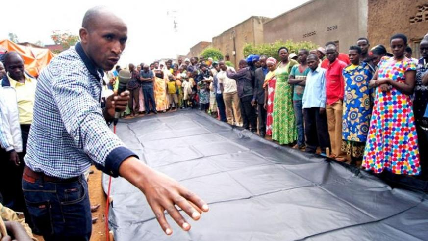 Farmers in Nyagatare admire the Grain-Pro Collapsible Dryer Case last week. (Stephen Rwembeho)