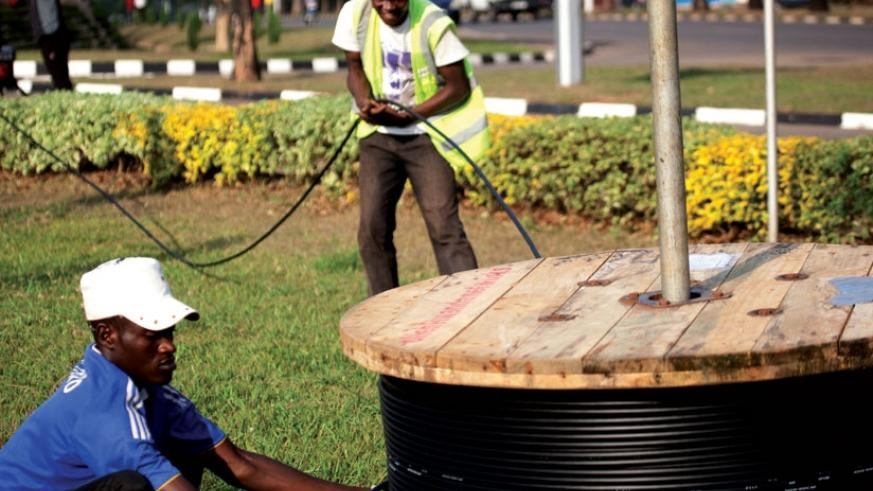 Workers laying fibre optic cables in Kimihurura, Kigali. Internet infrastructure like this is has been a priority for Rwanda to facilitate economic growth. (Timothy Kisambira)
