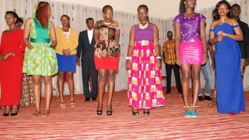 The founder of House of Shepherd fashion, Maureen Ainembabazi (wearing a long blue dress), poses for a photo with her models.