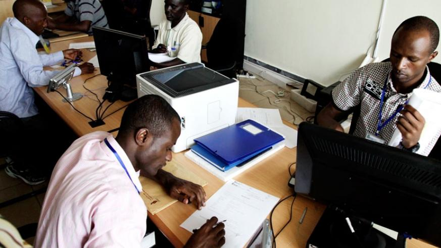 People register businesses at Rwanda Development Board. The Investment Code is expected to balance trade deficits in the country. (File)