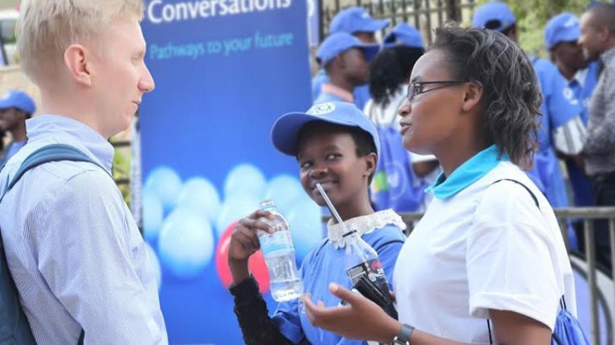 Participants chat with one of the Tigo managers after the workshop