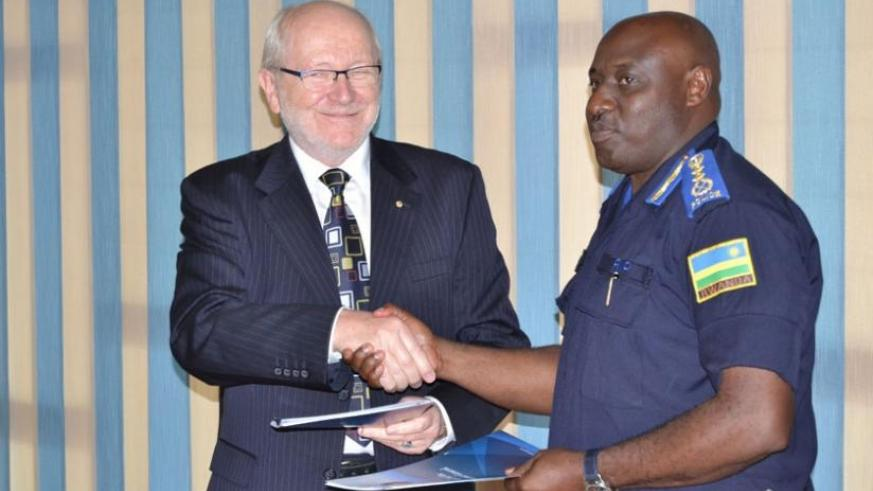Inspector General of Police, Emmanuel K. Gasana and Prof. James Mcwha, the Vice Chancellor of UR after signing the MoU yesterday. (Courtesy)