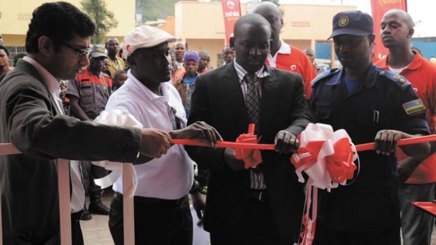 Bagyirisha (second, right) and Nsengayuimva (right) are joined by Airtel staff to  launch the service centre.