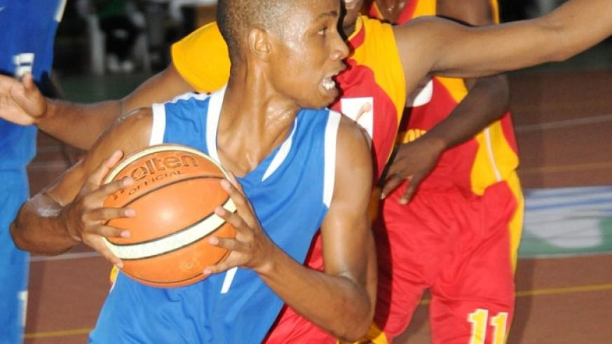 Lionel Hakizimana (left) now with league champions, Espoir, was part of the national U-18 team the last time Rwanda hosted the Fifa Afrobasket youth championship in 2010. (File)