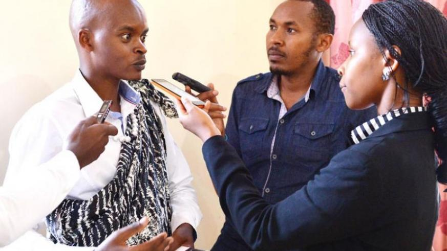 Boshya speaks to journalists at the launch of his book in Kigali yesterday. (Courtesy)