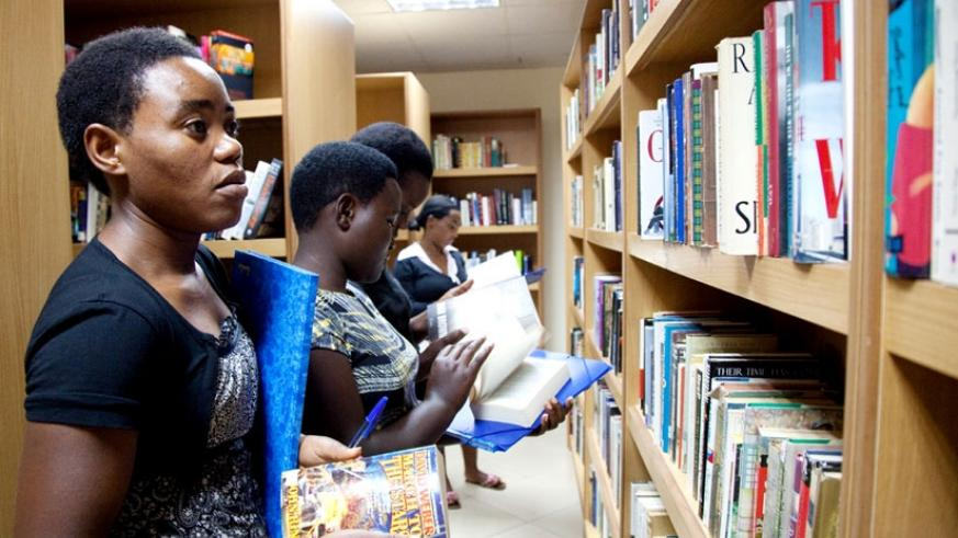 Students search for books at the Kigali Public Library. (File)
