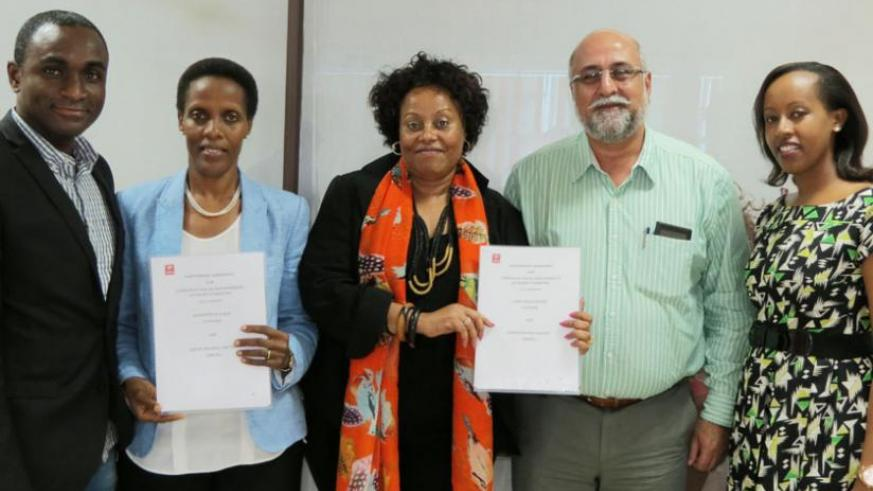 (L-R) Oware, Rugege, Balikungeri, Bhullar and Umunyana pose for a picture after the committee members received their appointment letters. (Ben Gasore)