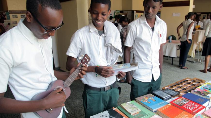 Students at a book fair recently. Students learn from each other during their meetings and activities. (John Mbanda)