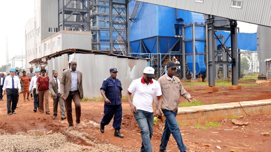 Prime Minister Anastase Murekezi and other officials tour the Gishoma Peat Power Plant in January. (Courtesy)