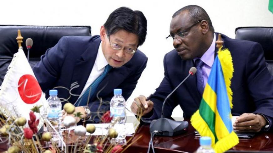 Finance minister Claver Gatete (R) chats with Ogawa at the signing ceremony in Kigali yesterday. (John Mbanda)