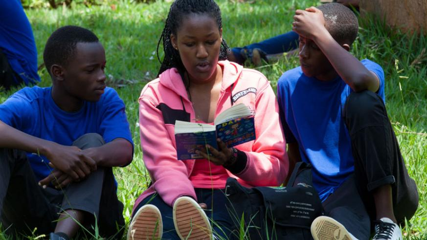 Green Hills Academy student (C) with peers of Nyamata High School read a book. Reading enhances concentration. (File)