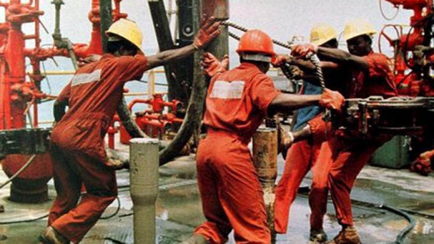 Workers operate an oil rig. Regional firms need to do more to benefit from opportunities in the oil sector.