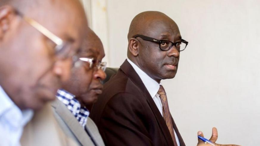 Justice minister Johnston Busingye (L) explains to members of the parliamentary Committee on Unity, Human Rights and Fight against Genocide what has been holding back the Judiciary in dispensing timely justice in Parliament yesterday.( Timothy Kisambira)