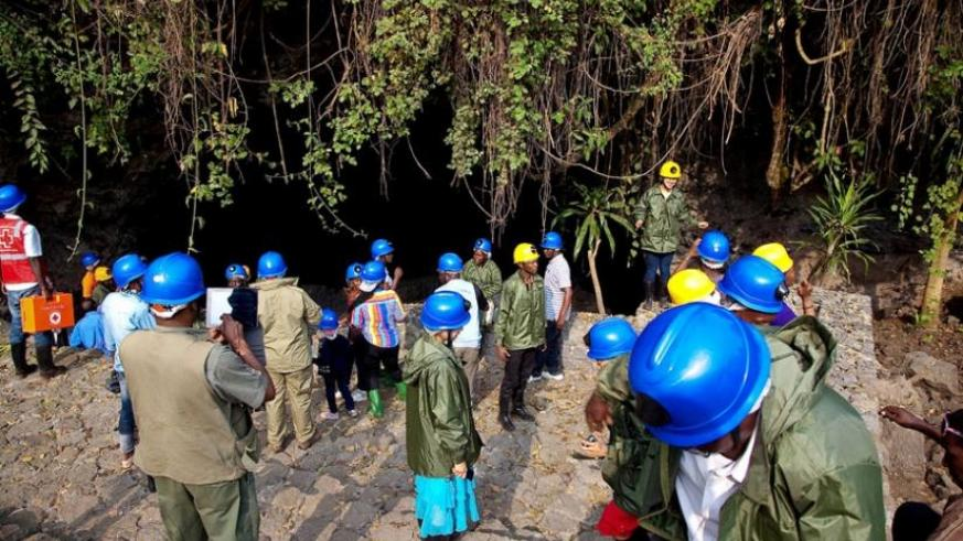 Tourists being briefed before embarking on a tour of the Musanze Cave. (File)