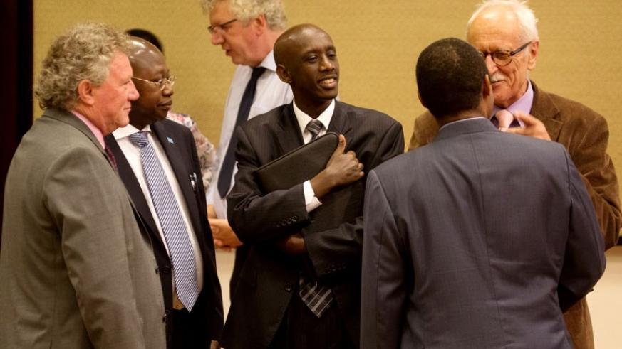 Minister Kaboneka (C), Prof. Shyaka (with back to camera) and other officials and development partners chat after the presentation of the 2014 Rwanda Governance Scorecard in Kigali yesterday. (All photos by Timothy Kisambira)