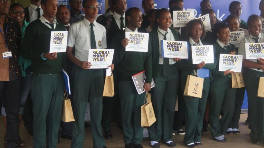 Green Hills Academy students display the certificates of attendance after a one-day training in financial literacy at I$M Bank. (Solomon Asaba)