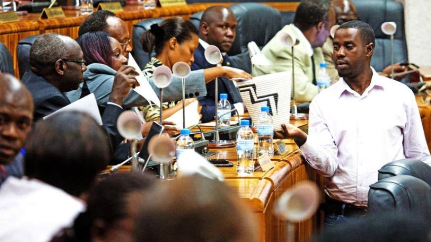 An electoral agent collects votes at Parliament yesterday. (John Mbanda)