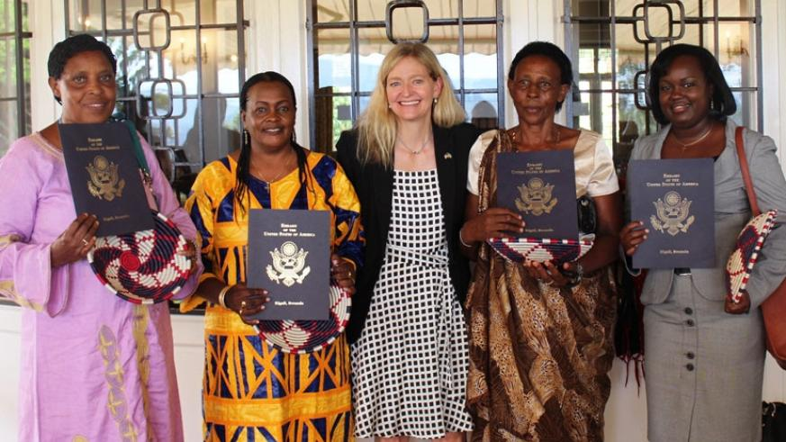 Amb. Barks-Ruggles poses for a picture with the award winners at her residence in Kigali on Thursday. (Courtesy)