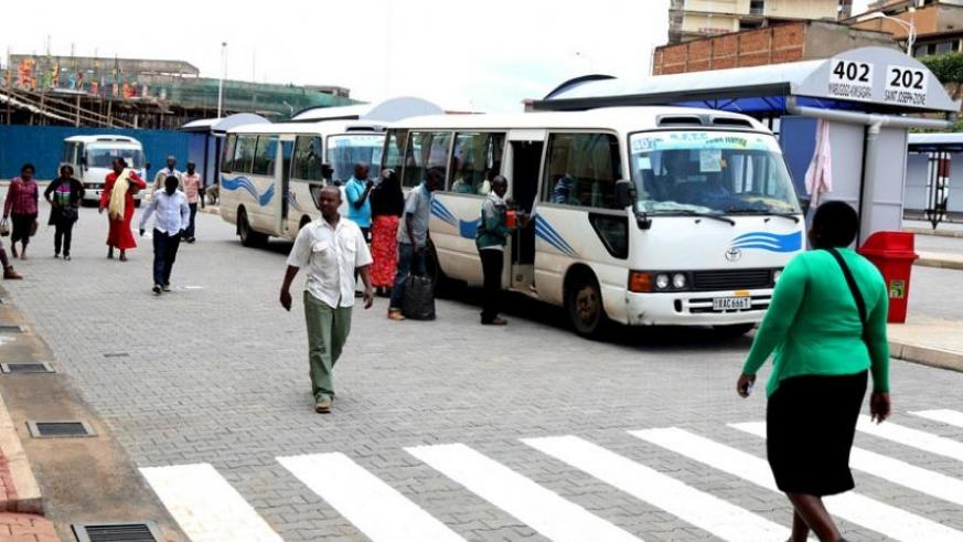 Passengers at the new bus terminal yesterday.  Both passengers and drivers are optimistic the new terminal will help ease public transport in downtown Kigali. (J. Mbanda)