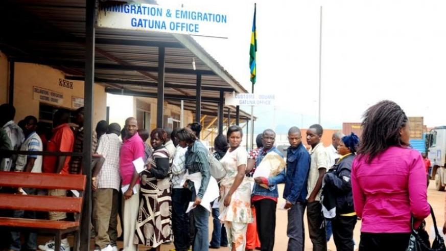 Travellers clear their documents at Gatuna border post with Uganda before crossing out of the country. (File)
