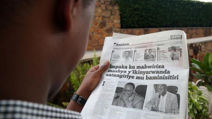A man reads a vernacular newspaper that recently reported on the changes in Kinyarwanda language. (File)