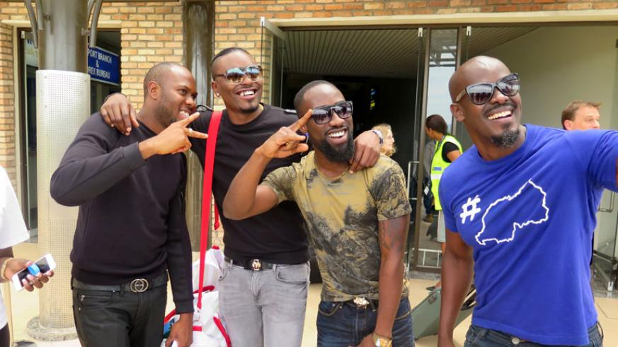 Frankie takes a selfie with Tayo and his entourage.