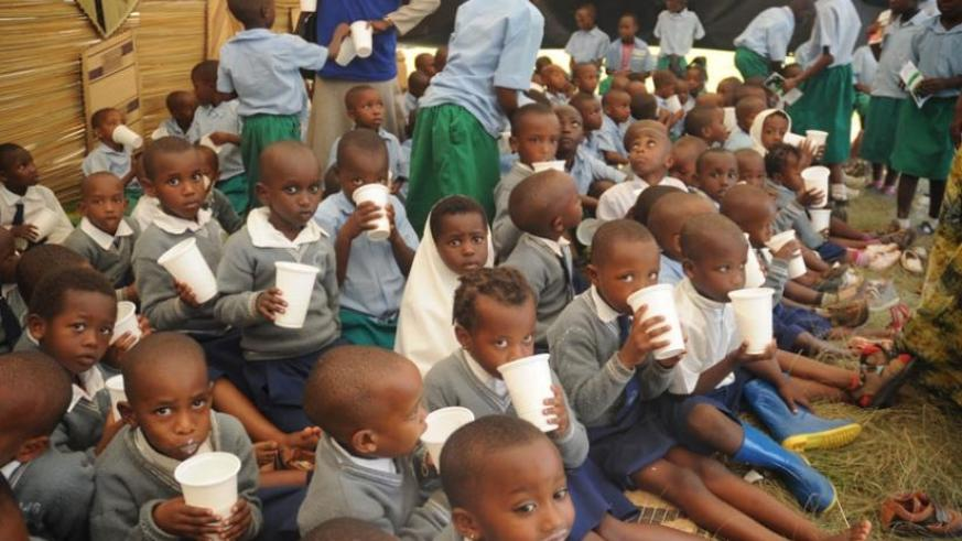 Children enjoy milk during a campaign against mulnutrition in 2013. (File)