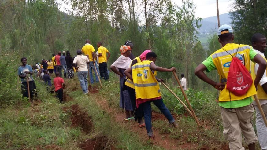 MTN staff and agents during Umuganda on Saturday. The telecom firm supports community initiatives. (Courtesy)
