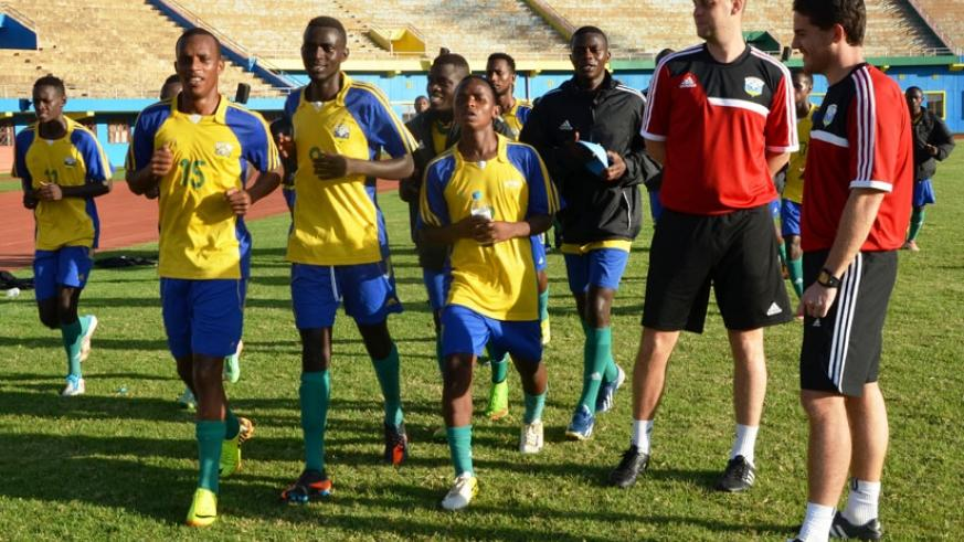 Amavubi head coach Johnny McKinstry (extreme right) oversees his team through their final preparations ahead of the Zambia friendly which Rwanda lost 2-0 on Sunday. (S. Ngendahimana)